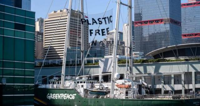 Greenpeace first custom-built campaigning vessel, motor-sail yacht Rainbow Warrior with a protest banner in Hong Kong last week. According to the print version of this article from The Irish Times, earlier this year 160 containers en route from Ireland to China for recycling were stopped in Rotterdam because of contamination. Click below to link on story on Ireland which over Christmas is to generate 83,000 tonnes of packaging waste, the equivalent volume that both Galway and Limerick would produce in a year.