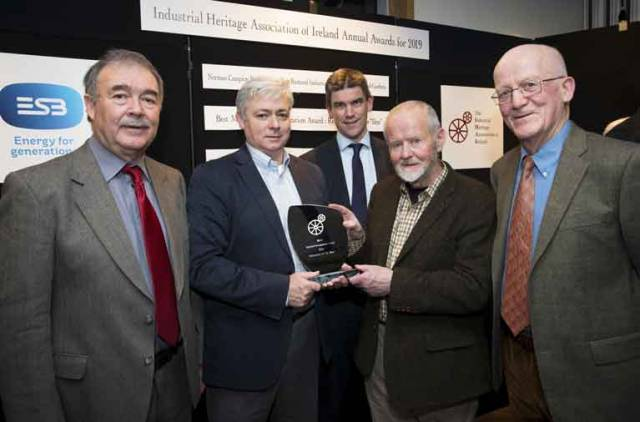 (L to R) Industrial Heritage Association of Ireland President Paul McMahon, Gary MacMahon of the Ilen Project, ESB Director Nicholas Tarrant, Father Anthony Keane (Ilen Project), and Michael English (IHAI Board Member) at the presentation of the IHAI's Best Restoration of 2019 .