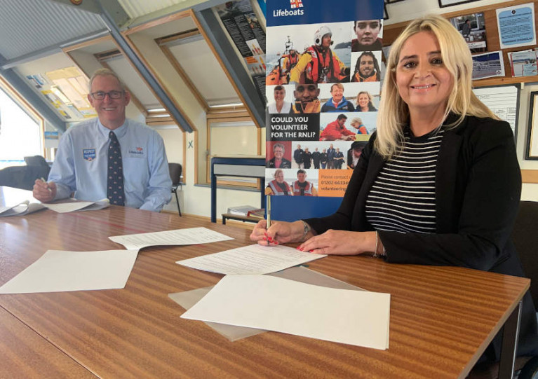 John Payne, director of lifesaving operations for the RNLI, and HM Coastguard director Claire Hughes sign the MOU at Dover Lifeboat Station on Thursday 1 October