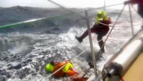 A shot from the dramatic rescue from the Pacific as caught on video from the deck of Derry~Londonderry~Doire