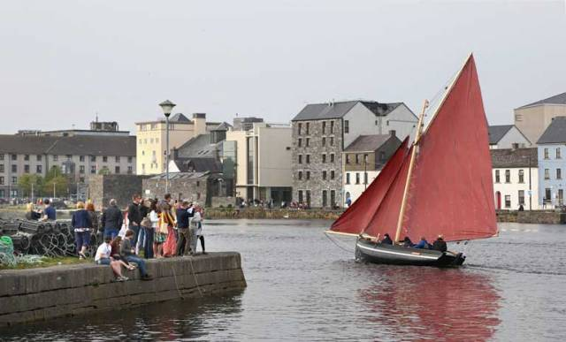 The restored 137 year-old Gleoiteog, the Lovely Anne, sails to Claddagh Quay during it's re-launch in Galway city. The boat, built in 1882, was restored as part of a community training project between Bádóirí an Cladaig and Galway Hooker 2020.