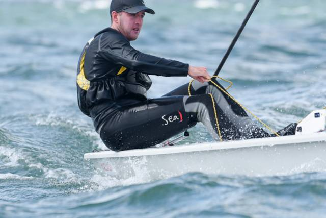 Rio Olympian Finn Lynch leads at the Laser Nationals at Royal Cork Yacht Club. Scroll down for gallery