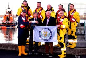 "At the presentation to Dun Laoghaire RNLI of the Cruising Association of Ireland cheque for €1,000 collected at the recent CAI ""Three Bridges Lifted"" Rally in Dublin Port were (back row, left to right) Chris Watson, Ronan Adams, Jack Shanahan, Damien Payne and Oisin Corrigan of Dun Laoghaire lifeboat, and front row (left) Station Mechanic Kieran O'Connell (left) and (right) Duty Cox'n Adam O'Sullivan, with Commodore Vincent Lundy of the CAI, and Honorary Treasurer Bryan Downey"