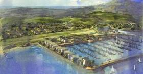 Holyhead marina in north Wales, with project images for the waterfront development planned by Conygar Stena Line at Newry Beach