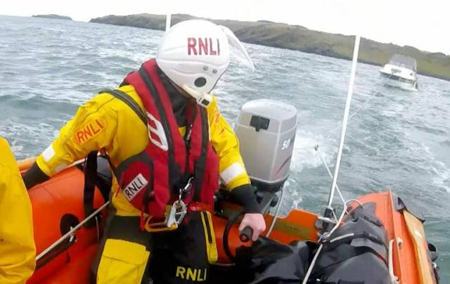 The RNLI Larne inshore boat ensured that the tow line was set up speedily and the two men onboard were brought to the safety of shore without delay