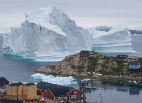The huge iceberg in Greenland has drifted close to a village on the western coast, threatening residents in case it splits resulting in waves swamping homes.