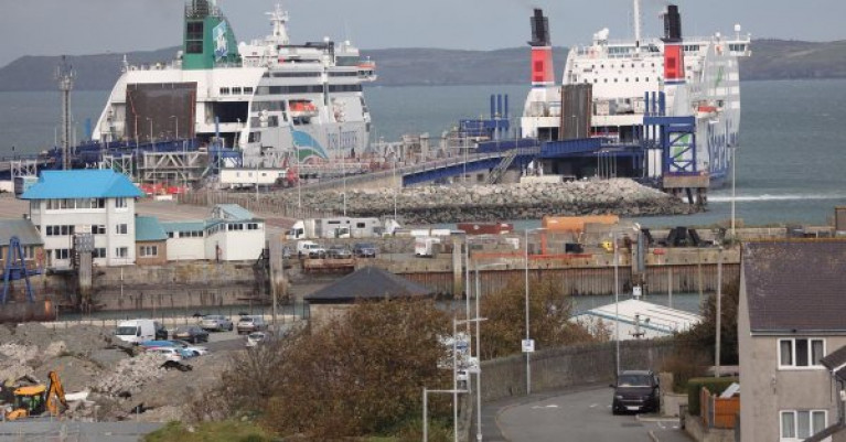 Some freight services continue between Wales and Ireland AFLOAT adds on the core Irish Sea short route service between Holyhead and Dublin Port. Above at the north Wales port berthed at Salt Island is Ulysses of Irish Ferries and Stena Adventurer operated by Stena Line