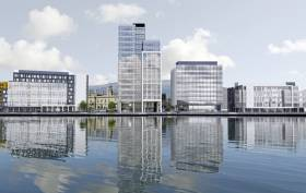 An artist's impression of how the new City Quays 3 will look, AFLOAT adds to the left of what will be Belfast's tallest office building supporting 500 jobs, is the existing historic building belonging to Belfast Harbour Commissioners completed in 1847.