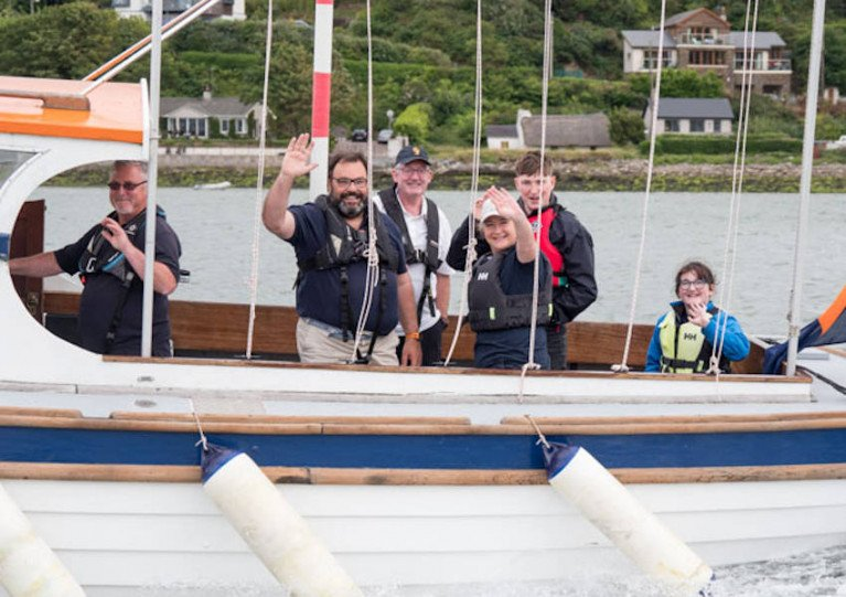 Royal Cork Admiral Colin Morehead (second from left) and crew on board club boat Adrielle