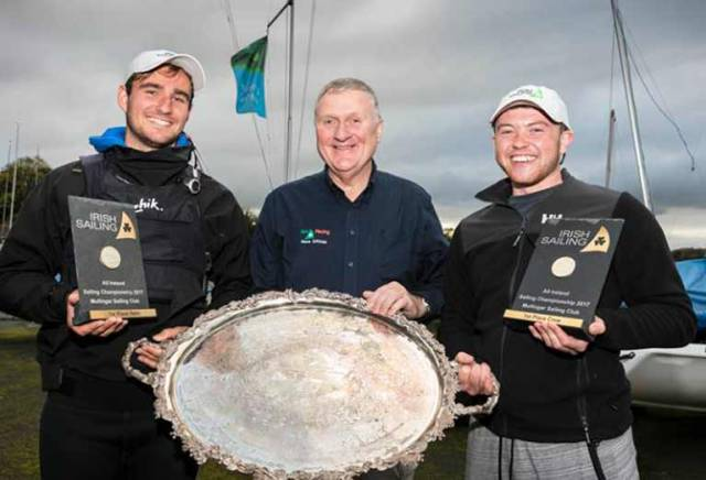 The silverware is going to Baltimore - 2017 Champion of Ireland Fionn Lyden (left) with Irish Sailing President Jack Roy and crew Liam Manning at Mullingar SC on Lough Owel this evening