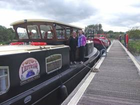 Mary McInerney with Waterways Ireland's Sinead Mallon on the 'boatel' Lovely Leitrim in Enniskillen this week