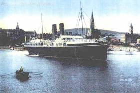 RMS Leinster moored in Kingstown (Dun Laoghaire) in between the East Pier and on the right of image the Carlisle Pier