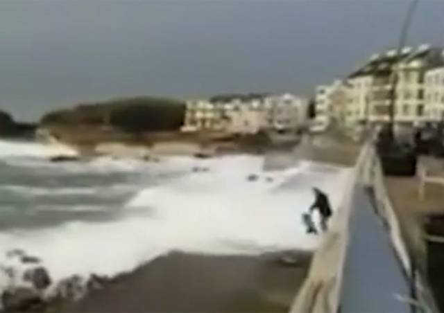 A still from the video showing the child swept off their feet by the wave at Portstewart's promenade