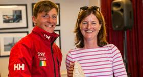Royal Cork's Johnny Durcan is presented with his Laser Leinster Radial prize by Susan Spain of the National Yacht Club. Prizegiving gallery by Joe Fallon below