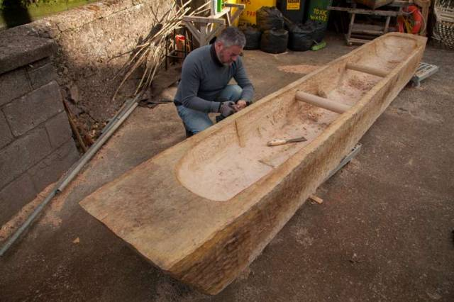 Master craftsman Mark Griffiths working on full scale replica of 2,400 year old logboat found on Connemara's lough Corrib