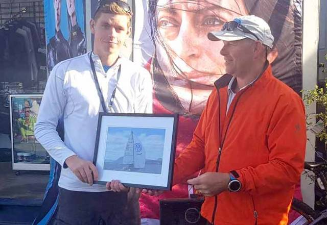 Howth Yacht Club's Cillian Dickson (left) accepts his prize as leading youth boat at the SB20 Worlds in Hobart