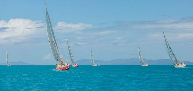 The Clipper Race fleet departing the Whitsundays earlier today