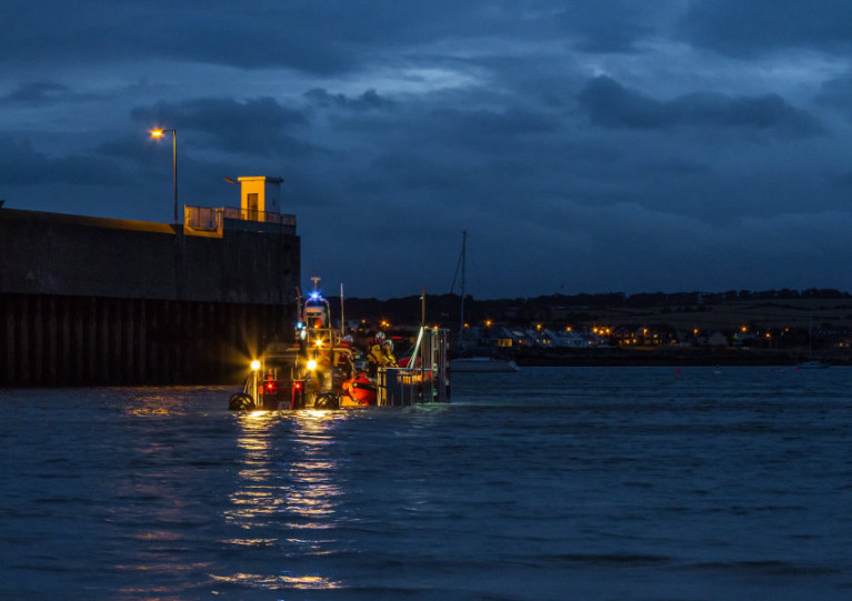 Skerries RNLI crew launch their inshore lifeboat in the rapidly fading light on Tuesday evening