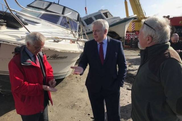 The Welsh First Minister Carwyn Jones on a visit this week to Holyhead Marina on Anglesey. The Welsh Government is to fund £100,000 to help businesses and promote tourism after havoc wreaked by Storm Emma took place in March.