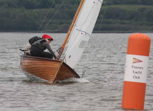 Darragh McCormack, Nigel and Jack Young close in on a weather mark at the Munster Mermaid Championships