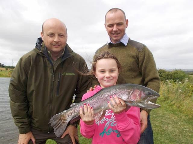 Alana Kerr (Age 9) of Dunmoe, Co.Meath, Brendan Kerr and Oisin Cahill of Inland Fisheries Ireland enjoying a fishing trip along with the Boyne Valley Fishing Hub at Courtlough Trout Fishery. The fishing trip was organised by the Dublin Angling Initiative