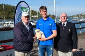 Irish Sailing President Jack Roy (left) with Radial winner Jamie McMahon and RCYC Admiral Pat Farnan. Scroll down for gallery of prizegiving photos