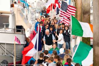 Howth Yacht Club Race Officer Harry Gallagher among the 185 Optimist competitors at the National Championships Opening Ceremony at HYC