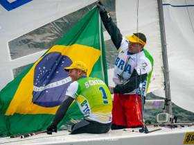 Winners Robert Scheidt and Henry Boening of Brazil celebrate victory on Lake Garda