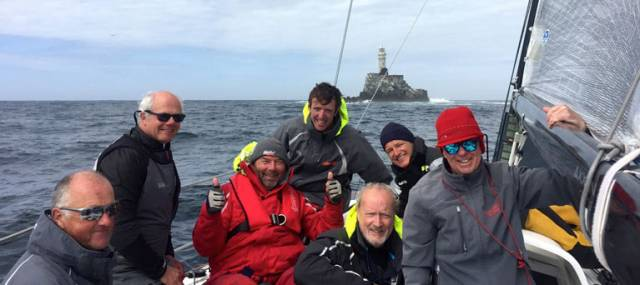 Tectonic shift? Fingal islet of Rockabill nears the Fastnet Rock?? Leading the Dun Laoghaire-Dingle Race approaching the Fastnet Rock, the JPK 10.80 Rockabill VI's crew are ahead on the water and on handicap, but ace helm Mark Pettit (left) doesn't at all approve of frivolity. However, photographer Will Byrne managed to get a smile out of (left to right) Ian O'Meara, Rees Kavanagh, Conor O'Higgins, Peter Wilson, Ian Heffernan and heavily disguised owner-skipper Paul O'Higgins