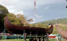 A 50–foot Viking longboat is lifted off a trailer in advance of filming on Lough Dann in County Wicklow for the Viking TV series. Plans are afoot to locate one of the Norse boats at Dun Laoghaire Harbour
