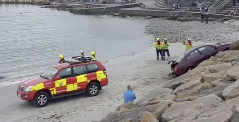 The Nissan Almera reversed over the pavement at Salthill promenade and fell about six metres (20 ft) down towards the beach.