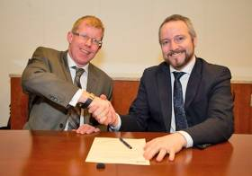 Inland Fisheries Ireland CEO Dr Ciaran Byrne and SEAI chief executive Jim Gannon confirm their partnership on energy savings