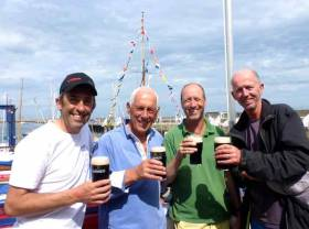 "Summer sailing time in Ireland. The crew of the 1897-vintage 37ft Myfanwy from Wales celebrate ""the best five days of sailing in our lives"" after the last race of Volvo Dun Laoghaire Regatta 2017. And this was before they heard that they'd won the Kingstown 200 Cup – the winning crew are (left to right) Max Mason, Rob Mason, Andy Whitcher and Gus Stott. Photo: W M Nixon"