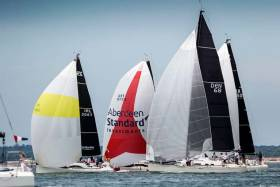 Fools Gold (white spinnaker with yellow band) as a bunch of competitors struggle for clear air at the IRC Europeans on the Solent