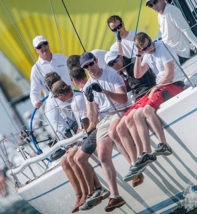 Anthony O'Leary (white cap) is a tireless campaigner who has twice been named the Irish Sailor of the Year and regularly competes in both small planing one-designs and larger offshore events