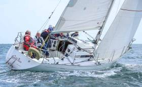 After nearly two hours of racing in up to 20–knots of wind, Gwilli Two (above) won by less than one foot off Greystones