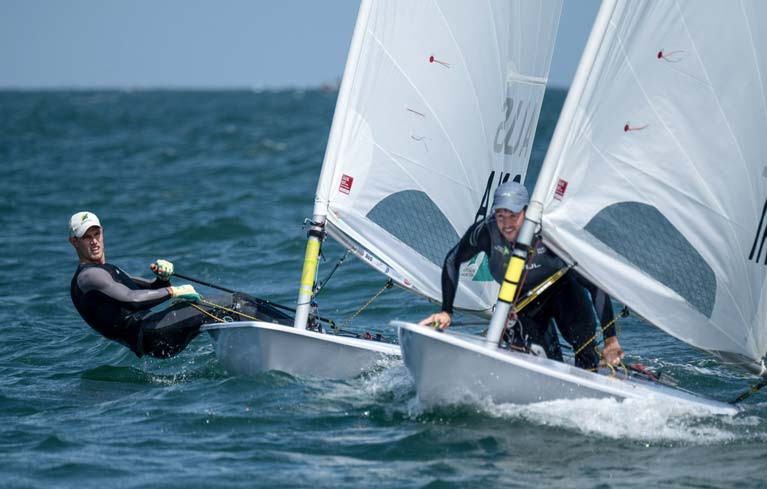 Finn Lynch (IRL) lee-bows Matthew Wearn (AUS) to take the gun in gold fleet race 10 at the Laser Worlds in Melbourne