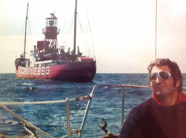 Man of the sea. Hugh Kennedy at the helm of his Clare Lallow-built classic Tosca IV, putting the Coningbeg Lightvessel astern during the annual summer pilgrimage to Baltimore in West Cork