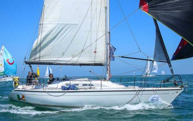 The successful two-handed Dehler 34 Big Deal from Foynes (Derek and Conor Dillon) just after setting her spinnaker shortly after the start of the Volvo Round Ireland race 2018. All loose lines were soon aboard