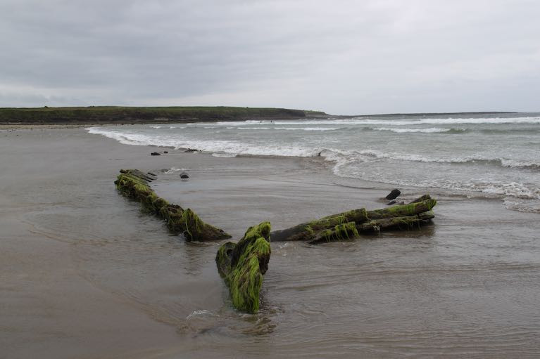 "The remains of the large, wooden vessel on Streedagh Strand in Sligo,known locally as the 'Butter Boat"", and now identified as a 1770 shipwreck named Greyhound which claimed 20 lives. One man - a Mr Williams 'from Erris' - was recorded as surviving the wrecking"