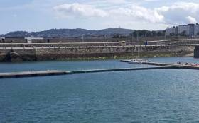 "A ""bridge"" between the pontoons in front of the National Yacht Club and the existing pontoons and platform is now in place at the East Pier in Dun Laoghaire Harbour"
