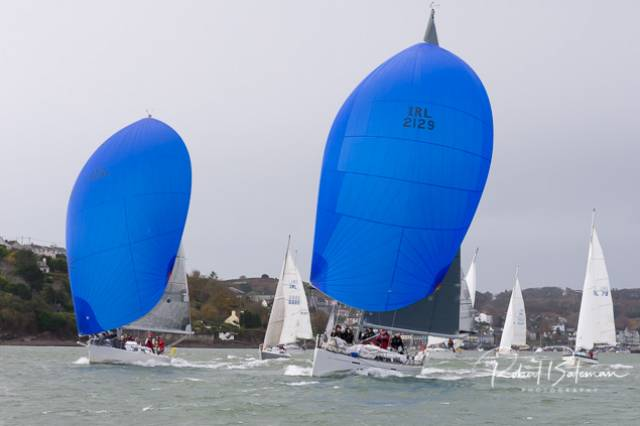 "Of the six spinnaker boats competing in the RCYC League today, two with blue kites above are helmed by dinghy sailors ""Nieulargo"" Annamarie and Denis Murphy's Grand Soleil 40 is helmed by daughter Mia (16). The Jones' Family  J109 is helmed by son Kian (20). See photo gallery below"