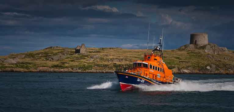 Dun Laoghaire's RNLI All weather lifeboat passes Dalkey Island on Dublin Bay