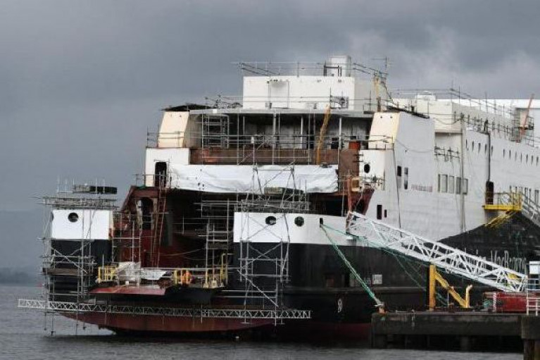 The Glen Sannox (Afloat adds seen at an earlier stage of the duel-fuel ferry's construction) at the Ferguson Marine shipyard located at Port Glasgow on the Clyde, Scotland