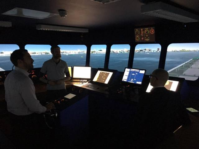 Capt. Conor Moynihan, demonstrating the NMCI's 360 full mission bridge simulator's capabilities