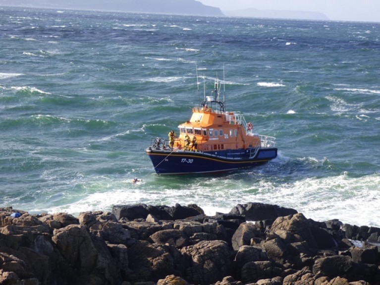Portrush RNLI Lifeboat approaches the teenager