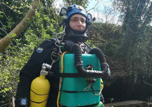 Jim Warny suited up for a subterranean dive near his home in Ennis this past April