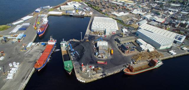 Among the short-sea traders docked in the Port of Ayr (foreground on right) AFLOAT adds is Ayress, operated by Coast Lines Shipping of Midleton, Co. Cork. On the quayside is round timber (logs) a typical cargo of the 1,713grt ship.