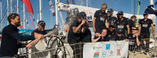The crew of HotelPlanner.com celebrate their ninth-place finish at the V&A Waterfront in Cape Town