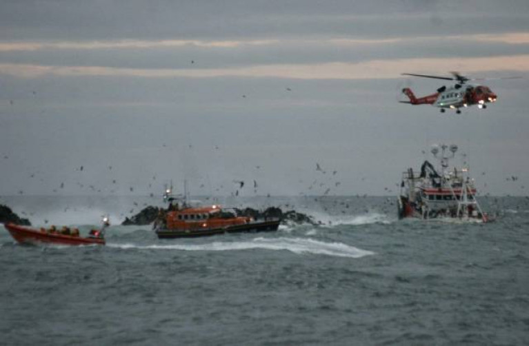 Portaferry and Newcastle RNLI working with Rescue 116 to rescue the crew of the grounded fishing boat in October 2019